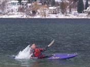 Rolling over in the frigid water of Kootenay lake
