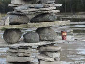 Life-sized inukshuk rising out of water
