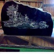 Black granite with deer sceen etching