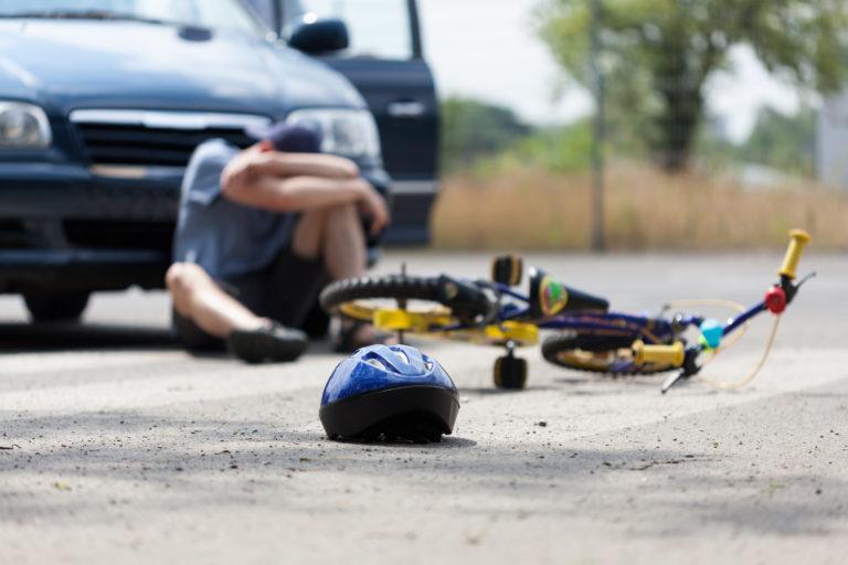 bicycle versus SUV accident