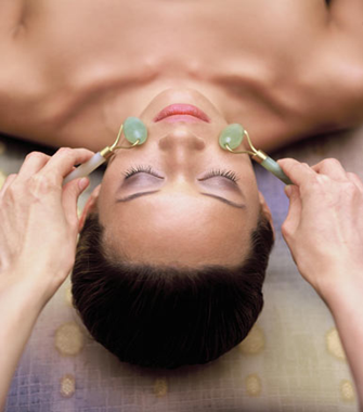 Facial treatment with jade skin rollers