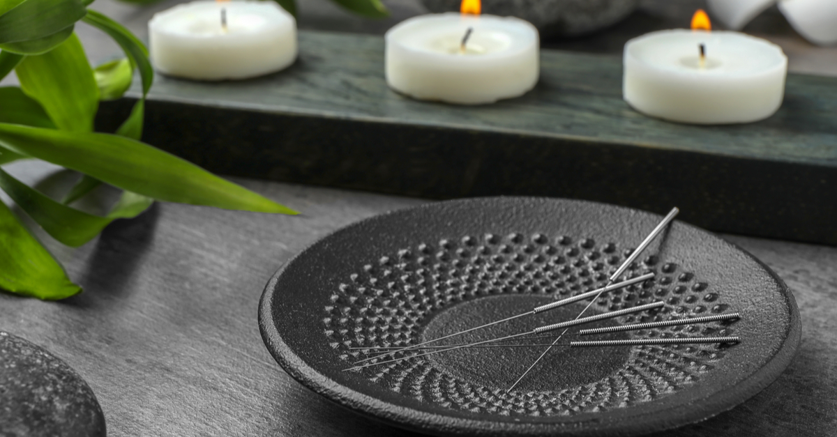 black plate holding acupuncture needles