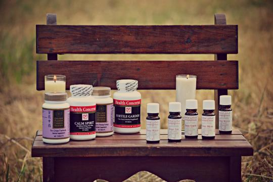 Chinese supplements, essential oils on wooden bench