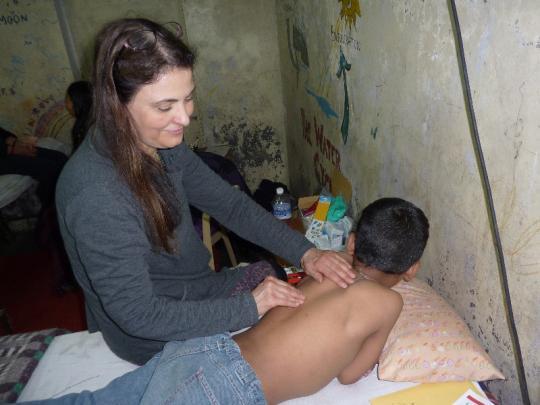 Dr Deborah Hipp working with hands on asian child