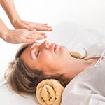 Woman receiving reiki healing