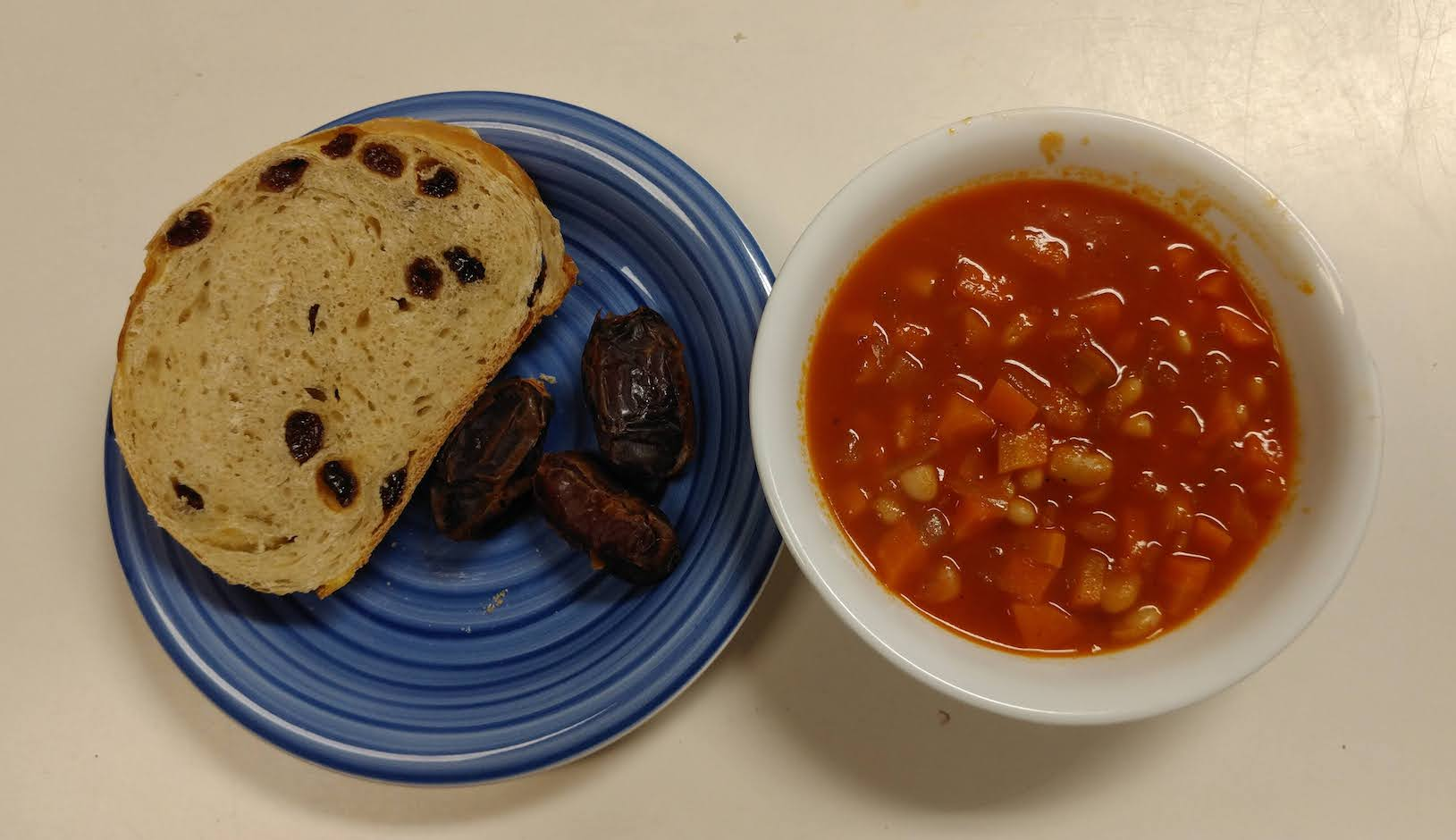 soup with side of bread and dates
