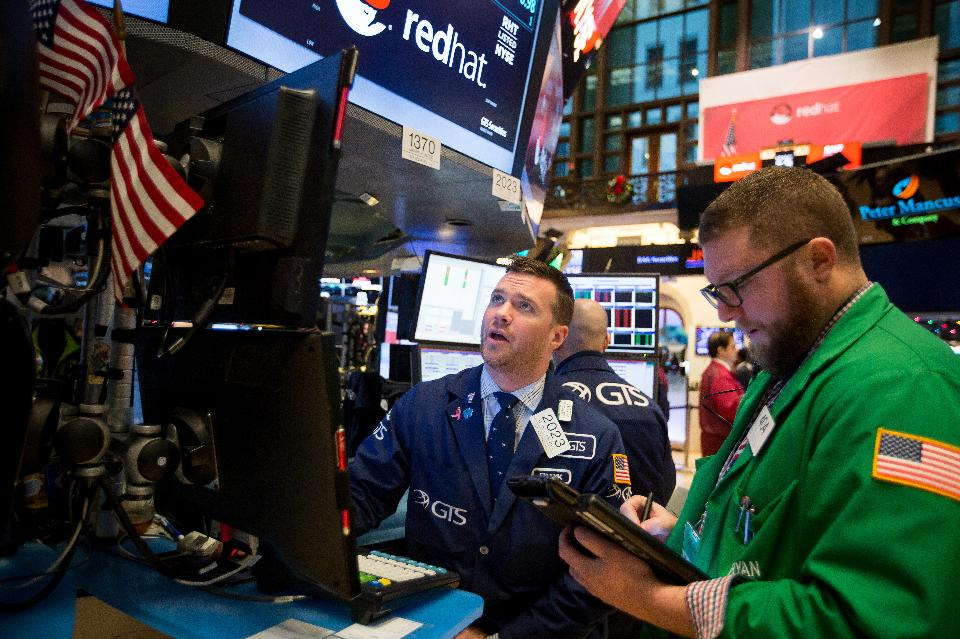 Traders work on the floor of the New York Stock Exchange (NYSE) in New York, U.S., on Monday, Dec. 12, 2016