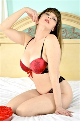 Nicole Ferreira Red Lingerie on Bed Poster
