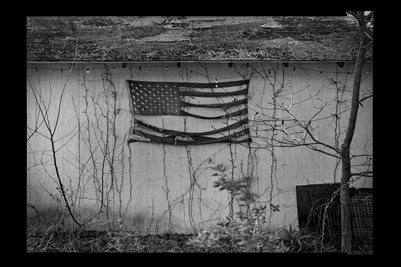Tattered Flag Poster. Black background.