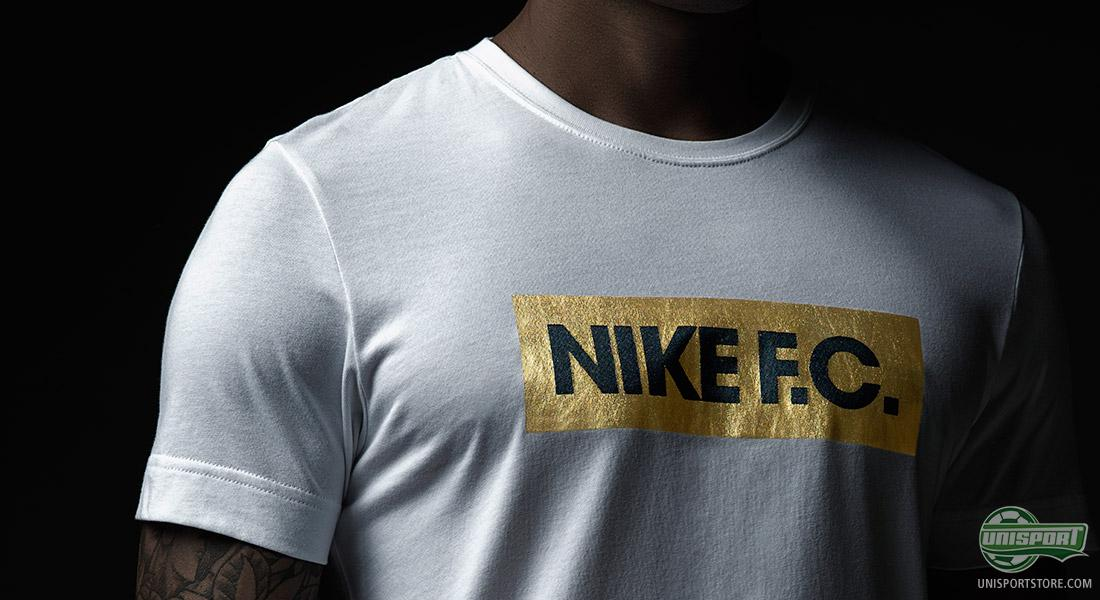 78775b7c The Nike F.C. t-shirt is made in black and white, with a gold Nike F.C.  block on the chest. The shirts are inspired by the shirt, which the  Brazilian ...