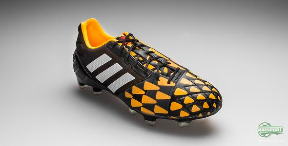 Adidas farger Nitrocharge i sort og oransje i Tribal Pack