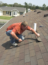 Taking an examination of a home's shingles