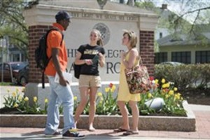 Students in front of Saint Rose Sign near Madison