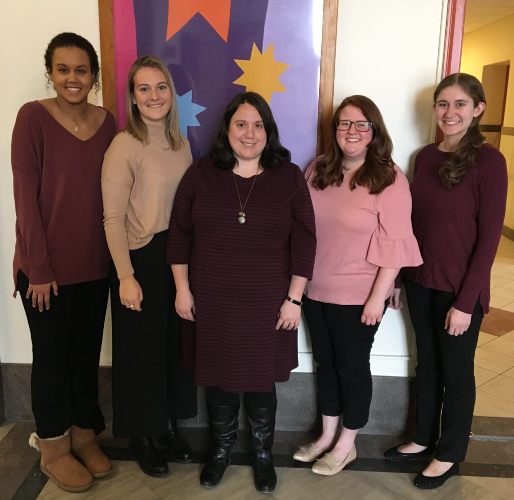 """Saint Rose Professor Katlyn Farnum standing with students who won the Psi Chi International Honor Society award with their project """"The Influence of Legal Knowledge on Retaliation."""""""
