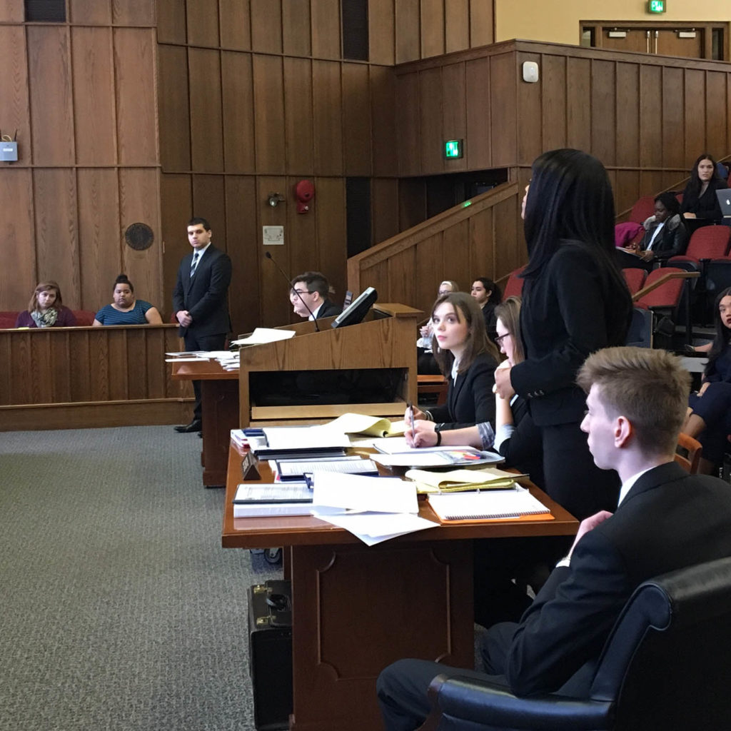 Student on the Mock Trial Team shown competing in a court room setting.