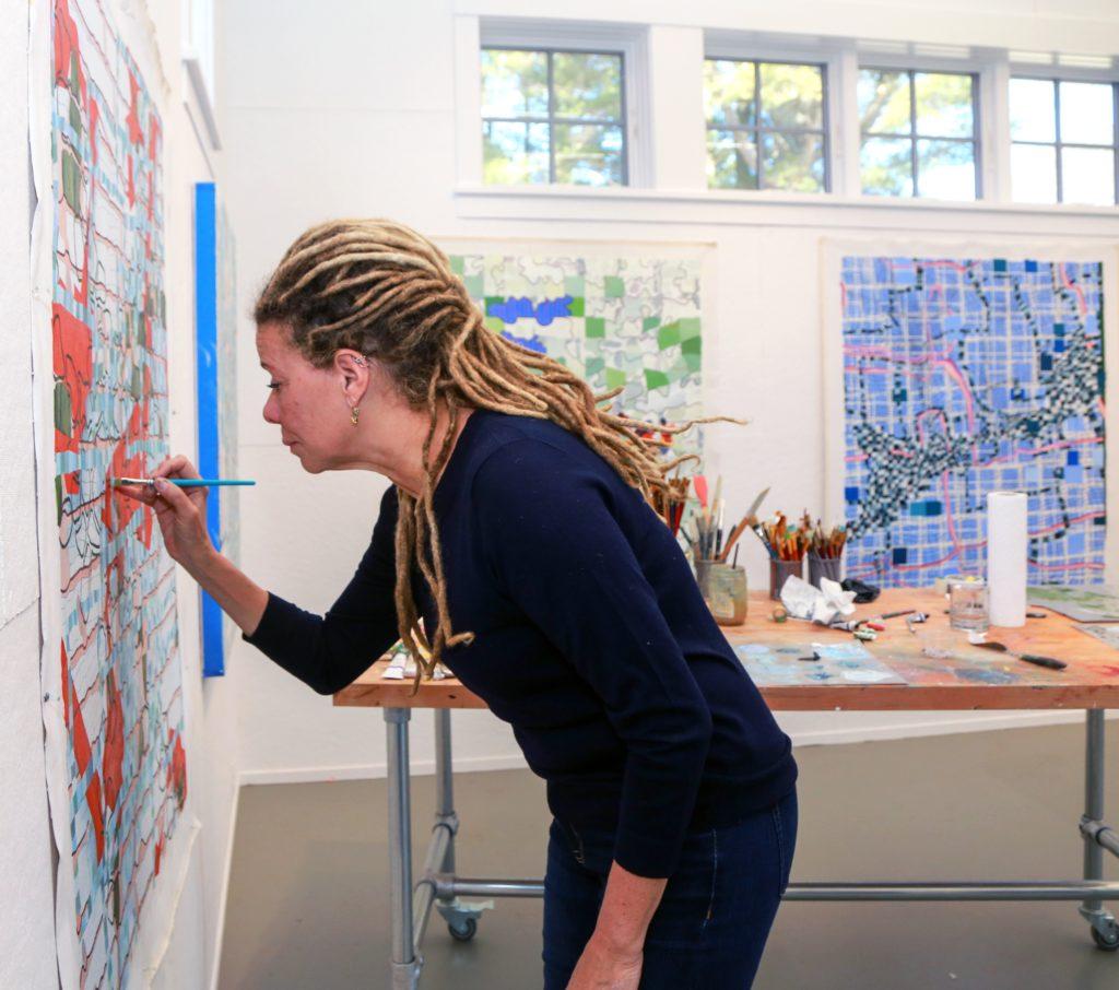Photo of artist Lisa Corinne Davis painting.