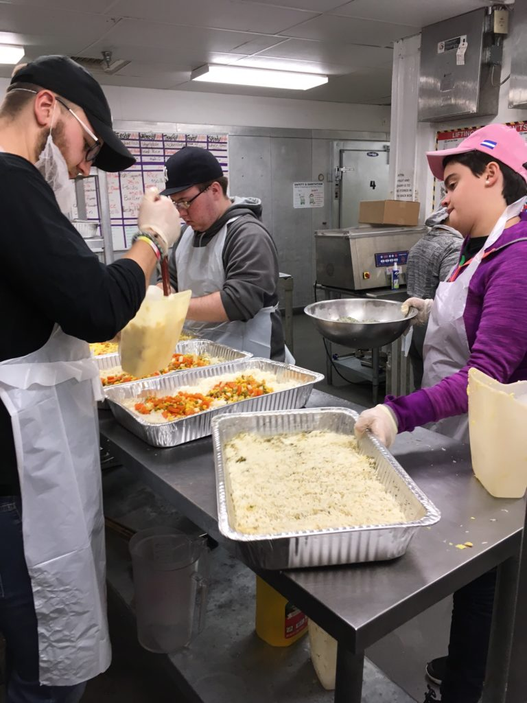 Saint Rose students preparing food at D.C. Central Kitchen, which serves those living in poverty.