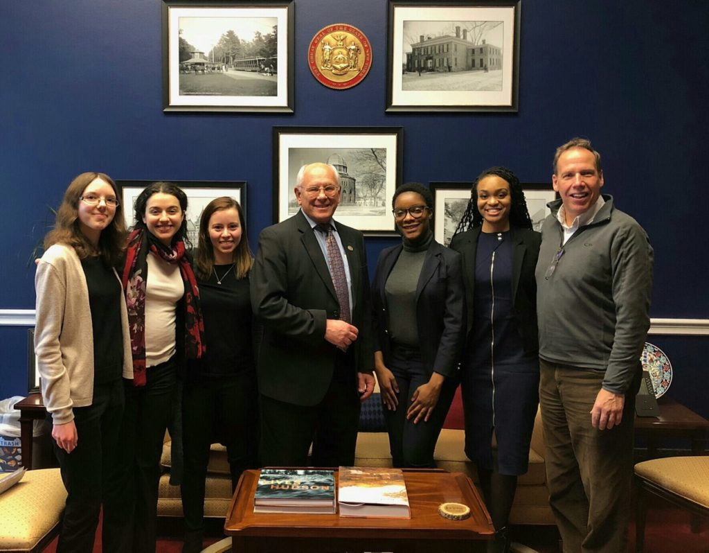 Saint Rose students standing with Congressman Paul Tonko in his Washington, D.C. office during their Winter Break service trip.
