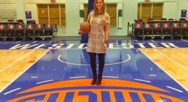 Erin Felix standing on the basketball court of the Westchester Knicks