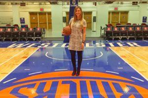 Erin Felix standing on the basketball court of the Westchester Knicks