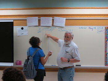 Tom Kerner teaching English as a second language.