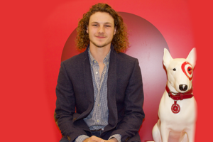 Saint Rose student Caleb Gregg posting in Target with the Target dog.