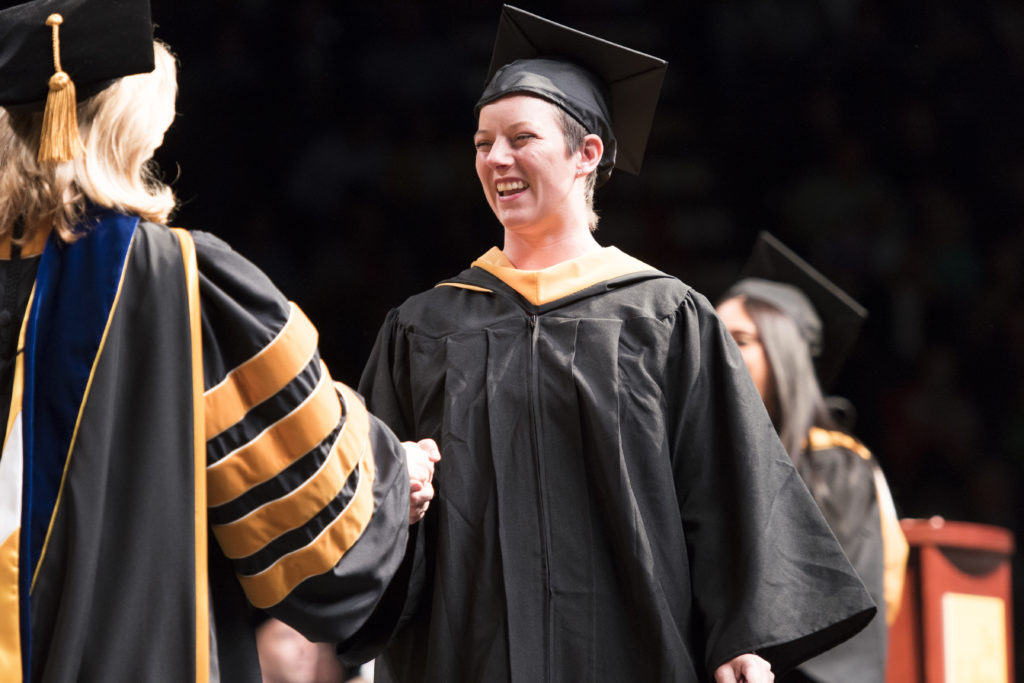 Crystal Plowinske receives her degree at Commencement in 2018.