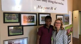 President Carolyn J. Stefanco with student at the African Leadership Academy.