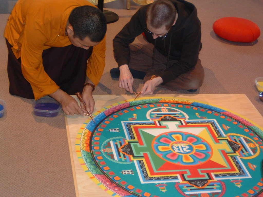 Lama Karma Chopal makes mandala in 2010 at Saint Rose