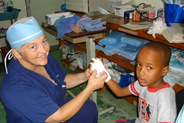 Dr. Patricia Fox helping a child in a medical clinic