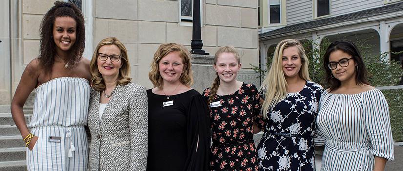 Saint Rose President Carolyn J. Stefanco with female Saint Rose students