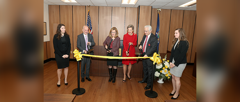 Saint Rose President Carolyn J. Stefanco and others cutting ribbon at mock trial courtroom dedication event