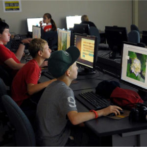 Students working on Applications on the Computer - Summer Academy