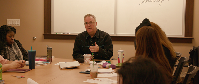 Saint Rose Professor Daniel Nester with students in poetry class
