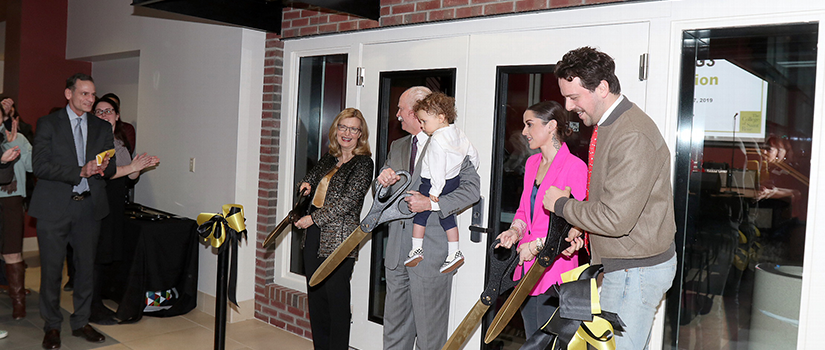 President Carolyn J. Stefanco and George R. Hearst III and family cutting the ribbon at the dedication for Studio G3