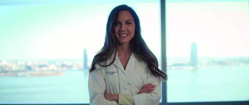 Leslie Beltran '08 at NYU in white coat