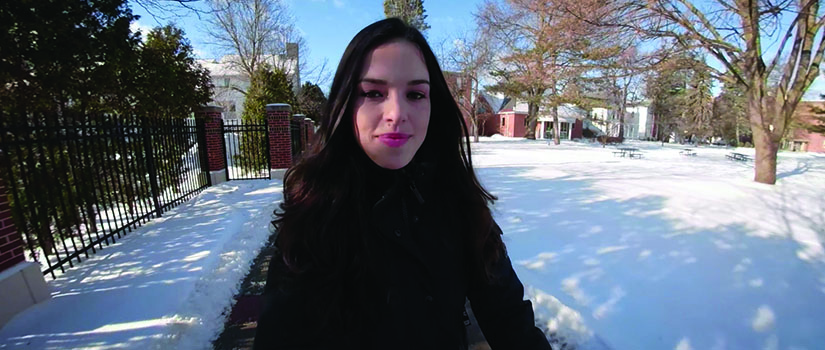 Liana Morales '19 walking at Saint Rose in the snow