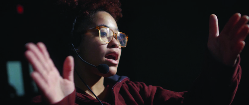 Female Saint Rose student in 22 minutes TV production class