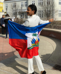 Myrdel Geffrard, orginally from Port-au-Prince, Haiti, holding out the flag of her home country.