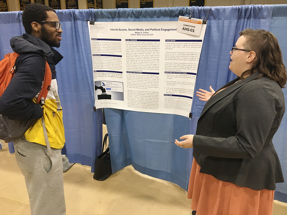 Communications student Megan E. Collins with her project