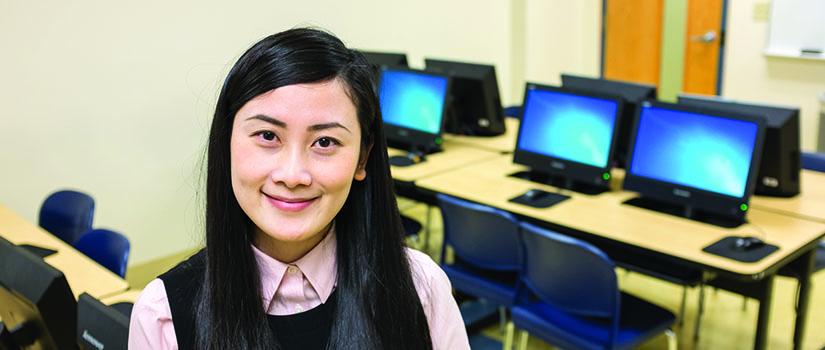 Dandan Wu, professor in the Huether School of Business