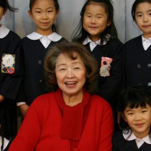 Toshiko Tanaka, with students, Saint Rose Alumni