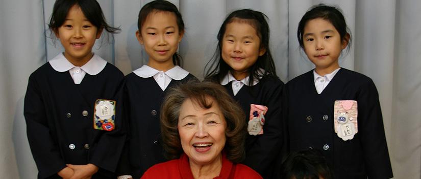 Toshiko Tanaka with students in Japan