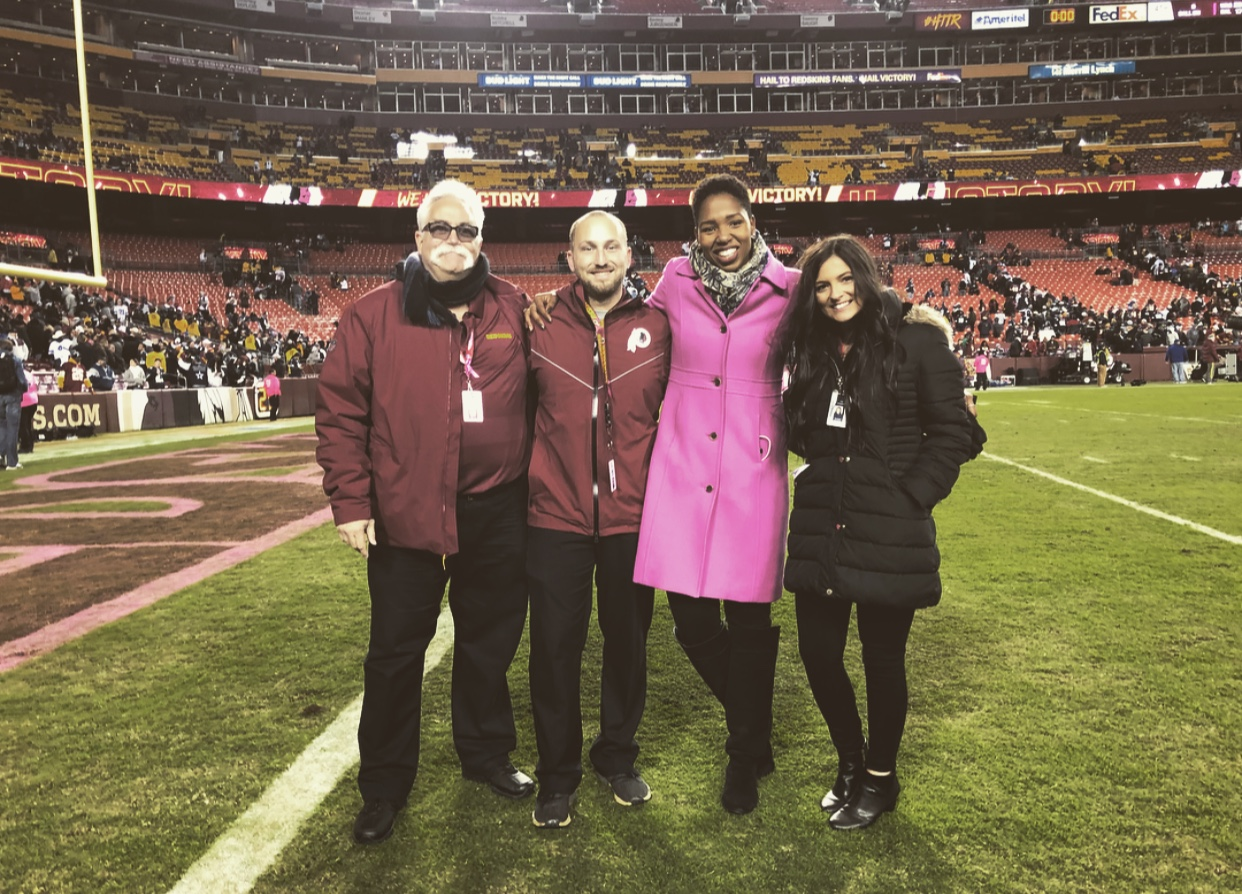 Sara Biancosino '17, far right, standing with three others on on FedExField.