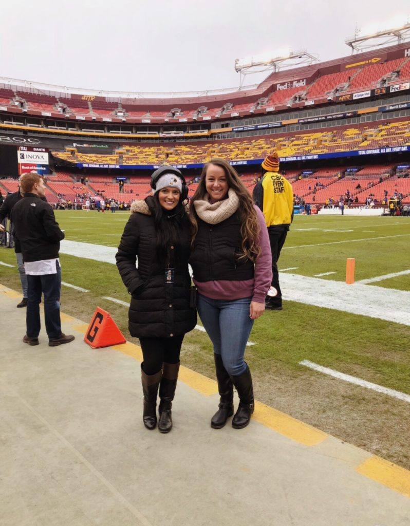 Sara Biancosino '17, at left, standing on FedExField with a friend