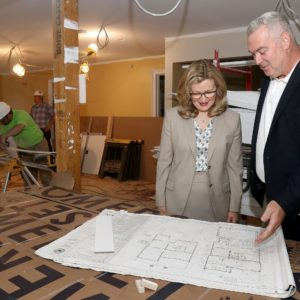 Saint Rose President Carolyn J. Stefanco looks at plans with the architect in the Michelle Cuozzo Borisenok '80 House