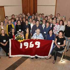 Saint Rose Class of 1969 group photo with 1969 banner