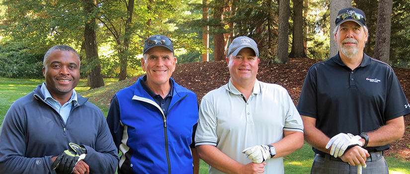 four male golfers at Golden Knights Golf Classic
