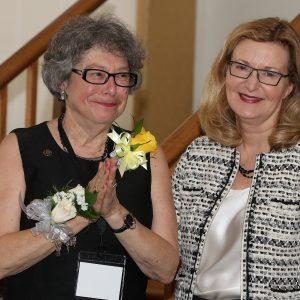 Saint Rose alum Sharon Maneri receiving an award from President Carolyn J. Stefanco