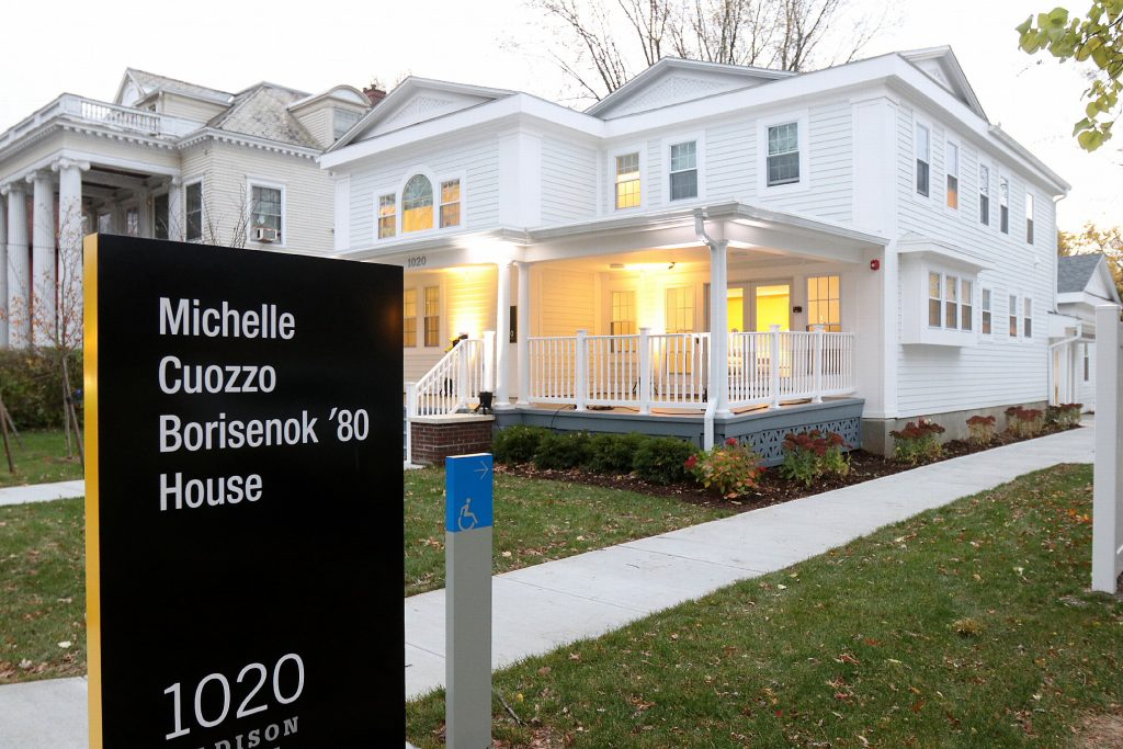 exterior of the Michelle Cuozzo Borisenok '80 House with sign bearing the house's name  in foreground
